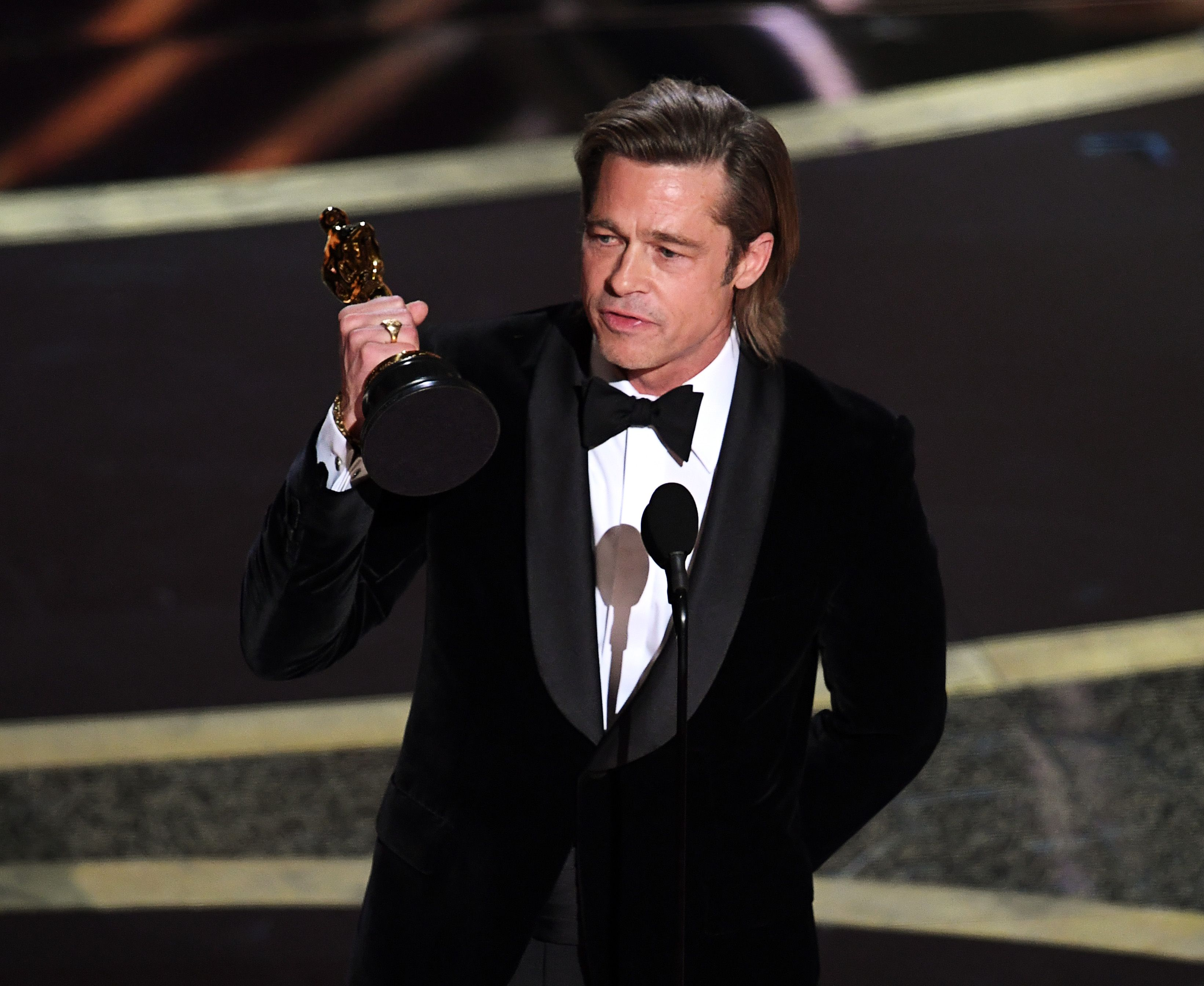 brad pitt accepts the actor in a supporting role award for news photo 1581297865